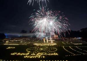 Fireworks illuminated the evening sky, earthen lamps dotted