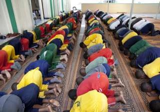 Kenyan Muslim school children offer Zohar prayers at a mosque on Tuesday, June 7, 2016, during Islam's holy month of Ramadan. Ramadan, which is calculated on the sighting of the new moon, began on June 6 in Kenya, where practicing Muslims worldwide abstain from eating, drinking, smoking and sexual activities from dawn to dusk.