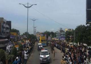 People line up on the streets of Hyderabad cheering P V Sindhu as she makes her way to the Gachibowli stadium.