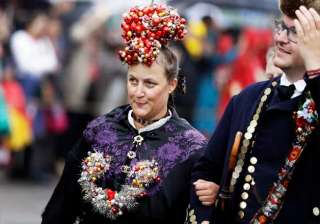 A woman with a fancy headgear participates in the traditional costume and riflemen parade on the second day of the 183rd Oktoberfest beer festival in Munich, southern Germany.