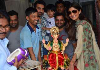Actress Shilpa Shetty brings home the idol of Lord Ganesh along with hubby Raj Kundra and son Viaan.