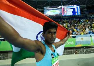 India's Mariyappan Thangavelu poses after winning the gold medal in the men's final high jump - T42 during the Paralympic Games at the Olympic Stadium in Rio de Janeiro on September 9, 2016