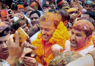 Uttar Pradesh BJP President Keshav Prasad Maurya celebrating with supporters as the early trends show the party's pyrrhic victory in the state assembly polls, at BJP office in Lucknow on Saturday.