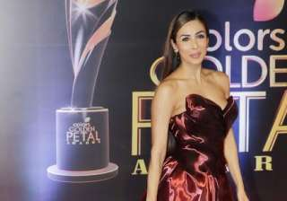 Actress Malaika Arora Khan stunned everyone in a red shiny gown. She was looking drop dead beauty. No doubt, she can easily make men go weak in knees.