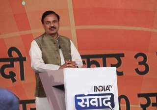 Union Minister of Culture and Tourism Mahesh Sharma attended the ongoing India TV Samvaad wearing military coloured cotton silk Nehru jacket.