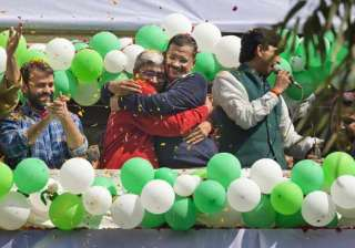 Aam Aadmi Party, leaders Arvind Kejriwal, center, and Ashutosh, second left, hug as they celebrate news of their party's performance in New Delhi.