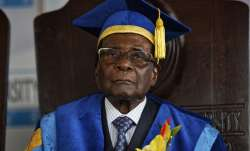 Zimbabwe's President Robert Mugabe sits for formal