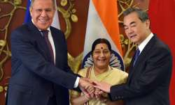 Sushma Swaraj with her Chinese counterpart Wang Yi and