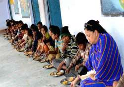 Vasundhara Raje having mid-day meal with kids at a