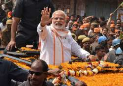 File pic of PM Narendra Modi during a road show in Varanasi - India Tv