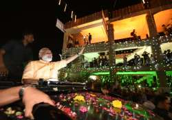 PM Modi reaches Surat, welcomed with road show