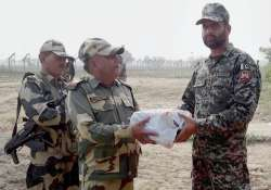 Jammu: BSF personnel exchange sweets with a Pakistan