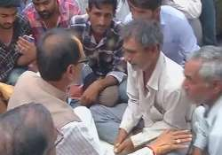 Shivraj Singh Chouhan meets families of victims of police