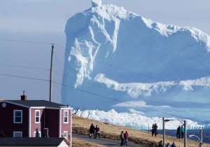 A 150-feet iceberg floats past Canadian village- India Tv