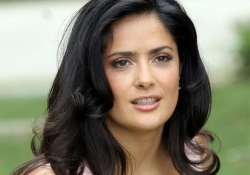 salma hayek says happiness makes her suited to comedy