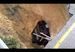 florida couple s car swallowed up by 10ft deep sinkhole