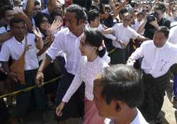 myanmar s suu kyi wins seat requests meeting with military