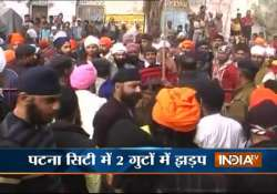 two sikh groups attack each other with swords in gurudwara