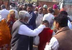 up minister slaps punches party worker