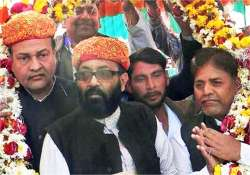 amar criticises cong for inducting ajit singh in union
