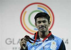 cwg 2014 omkar otari claims india s sixth weightlifting