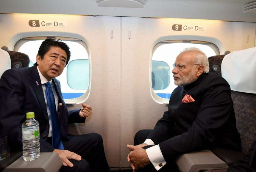 Prime Minister Narendra Modi and his Japanese counterpart Shinzo Abe on-board the Shinkansen bullet train to Kobe in Japan.