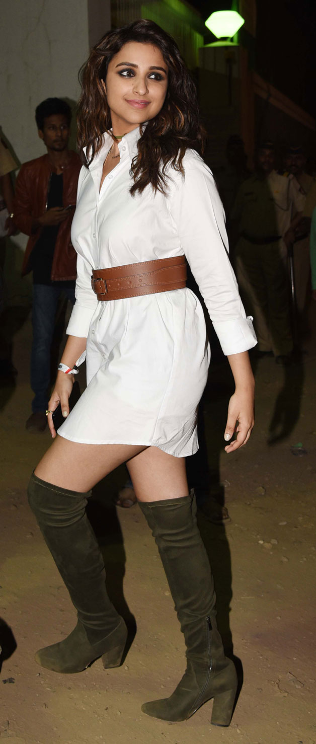Parineeti Chopra looked cool in her white button down shirt dress from Deme by Gabriella and cinched it at the waist with an obi belt from Bershka. Wearing her thigh high boots by Lulu and Sky as pants, she rounded her look out with Le Specs sunnies and unkempt hair.