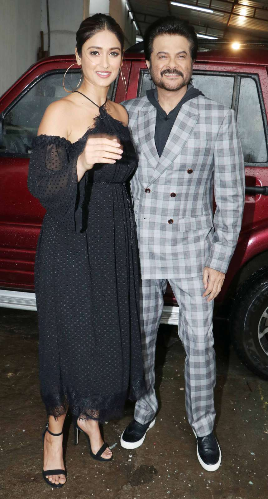 Anil Kapoor being a gentleman escorted Ilena D'cruz as we can see that.
