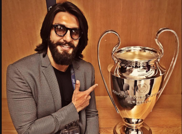 In this picture Ranveer can be seen posing with the coveted symbol of sporting glory that is the trophy of the UEFA champions league.