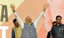 Prime Minister Narendra Modi waves to the crowd during