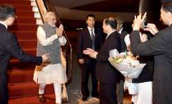 PM Narendra Modi is greeted by Chinese officials as he