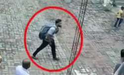 Video emerges of Lankan suicide bomber patting young girl's