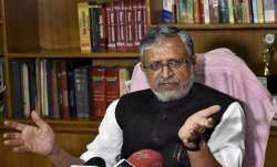 Sushil Modi draws flak for watching movie amid floods in