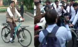 MPs ride bicycle to arrive at parliament for winter session