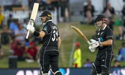 New Zealand's Martin Guptill celebrates his 50 runs during