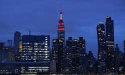 The Empire State building is lit in red and white lights to honor emergency medical workers Tuesday,