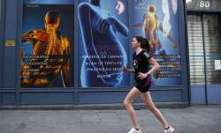 French IT consultant, Amelie Desroziers, 25, goes jogging for her daily one hour exercise during a n