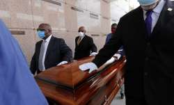 In this April 22, 2020, file photo, pallbearers, who were among only 10 allowed mourners, walk the c