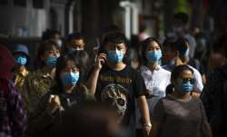 China reports 39 new coronavirus cases; total tally rises to 82,974