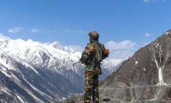 An Indian army soldier stands guard at Zojila Pass situated
