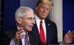n this April 22, 2020 file photo, President Donald Trump watches as Dr. Anthony Fauci, director of t