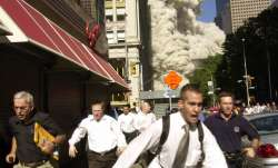 In this Sept. 11, 2001, file photo, people run from the collapse of one of the twin towers at the Wo