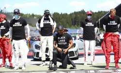 Mercedes driver Lewis Hamilton of Britain, centre, takes a