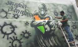 An artist draws a mural on a wall in Guwahati/FILE