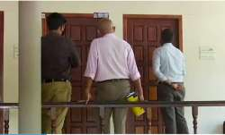 A three-member team of Customs officials at the residence of M Sivasankar to serve him a notice to a