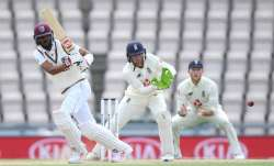 Roston Chase of the West Indies bats watched by England