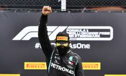 F1 star Lewis Hamilton raises right fist in fight against racism after winning Styrian GP
