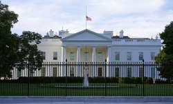An American flag flies at half-staff over the White House in Washington, Saturday, Sept. 19, 2020. F