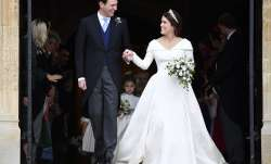 Britain's Princess Eugenie and Jack Brooksbank leave St George's Chapel after their wedding at Winds