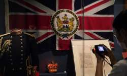 The standard and uniform of the former British Governors of Hong Kong, are displayed at the exhibiti
